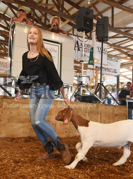 Harold Aughton/Butler Eagle: Apryl Scott of Butler parades her Grand Champion goat during the 42nd Annual Junior Livestock Market Sale at the Butler Farm Show.