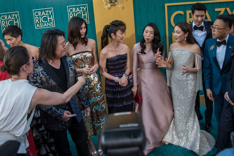 HOLLYWOOD, CA - AUGUST 07: Nina Jacobson, Sonoya Mizuno, Kevin Kwan, Gemma Chan, Michelle Yeoh, Awkwafina, Constance Wu, Chris Pang, Nico Santos, Jimmy O. Yang and Ken Jeong and Jon M. Chu arrive at Warner Bros. Pictures' 'Crazy Rich Asians' Premiere at TCL Chinese Theatre IMAX on Tuesday, August 7, 2018 in Hollywood, California. (Photo by Tom Sorensen/Moovieboy Pictures)