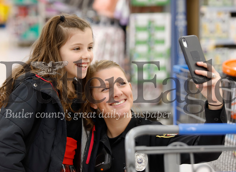 Butler deputy Darah Danner poses for a selfie with her Shop with a Cop partner Carlynn Ukaskik , 9, at the Butler Walmart Friday. Seb Foltz/Butler Eagle