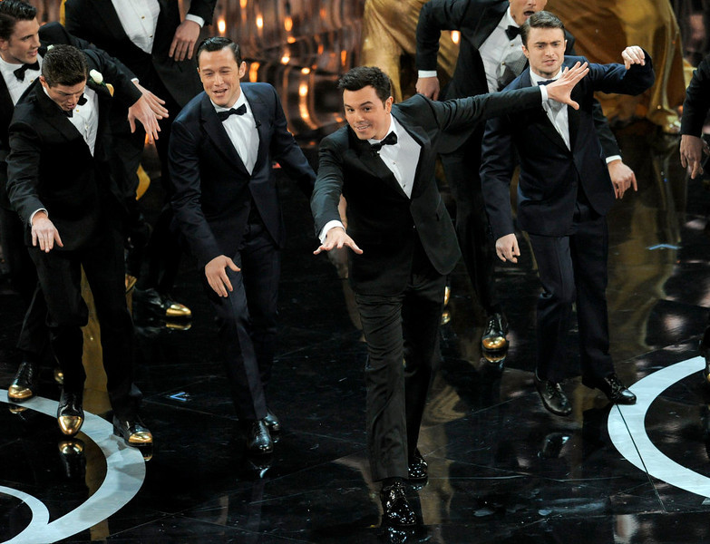 . From second left, actors Joseph Gordon-Levitt, Seth MacFarlane and Daniel Radcliffe perform onstage during the Oscars at the Dolby Theatre on Sunday Feb. 24, 2013, in Los Angeles.  (Photo by Chris Pizzello/Invision/AP)