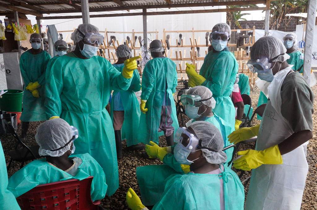 . 2014: Ebola fighters. Health care workers inside a USAID, funded Ebola clinic with their Ebola virus protective gear in Monrovia, Liberia, Jan. 30, 2015. (AP Photo/ Abbas Dulleh)