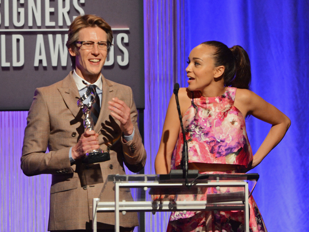 . Presenters Gabriel Mann (L) and Ashley Madekwe speak onstage during the 15th Annual Costume Designers Guild Awards with presenting sponsor Lacoste at The Beverly Hilton Hotel on February 19, 2013 in Beverly Hills, California.  (Photo by Jason Merritt/Getty Images for CDG)