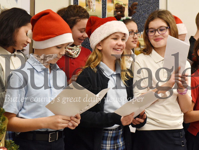 Harold Aughton/Butler Eagle: Butler Catholic students from Katie Neubert's music class sung traditional and non-traditional Christmas carols for the residents gathered in the recreation room of Newhaven Court Thurs., Dec. 19, 2019.