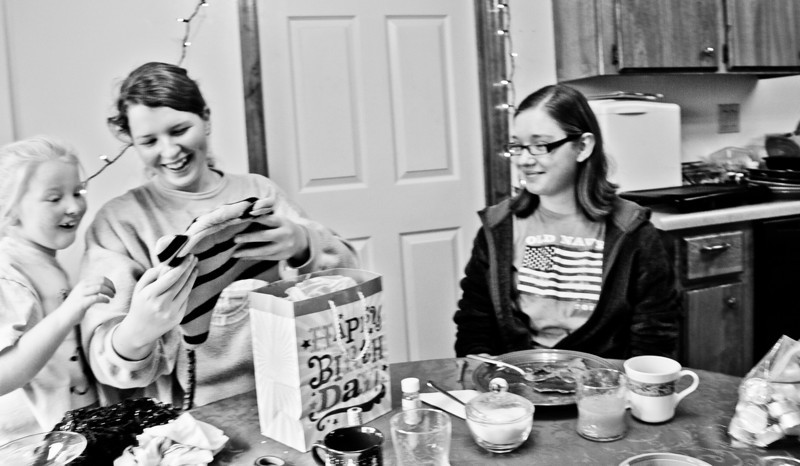 Abigail opening gifts from her friend, Rebecca.