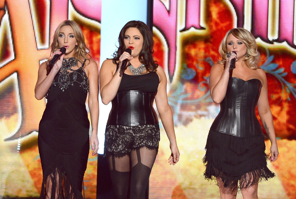 . (L-R) Singers Ashley Monroe, Angaleena Presley, and Miranda Lambert of Pistol Annies perform onstage during the 48th Annual Academy of Country Music Awards at the MGM Grand Garden Arena on April 7, 2013 in Las Vegas, Nevada.  (Photo by Ethan Miller/Getty Images)