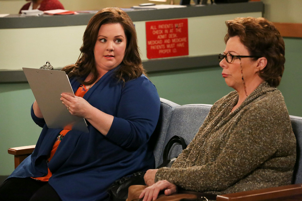 """. This image released by CBS shows Melissa McCarthy as Molly Flynn, left, and Rondi Reed as Peggy Biggs in a scene from \""""Mike & Molly.\"""" Mccarthy was nominated for an Emmy Award for best actress in a comedy series on Thursday, July 10, 2014. The 66th Primetime Emmy Awards will be presented Aug. 25 at the Nokia Theatre in Los Angeles. (AP Photo/CBS, Robert Voets)"""