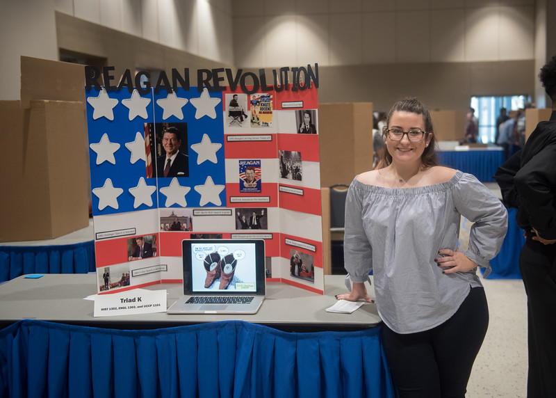 Student Kendal Larocque poses with her poster over the Reagan Revolution during the First-Year Symposium in the University Center.   View more photos: http://smu.gs/2fPPigh