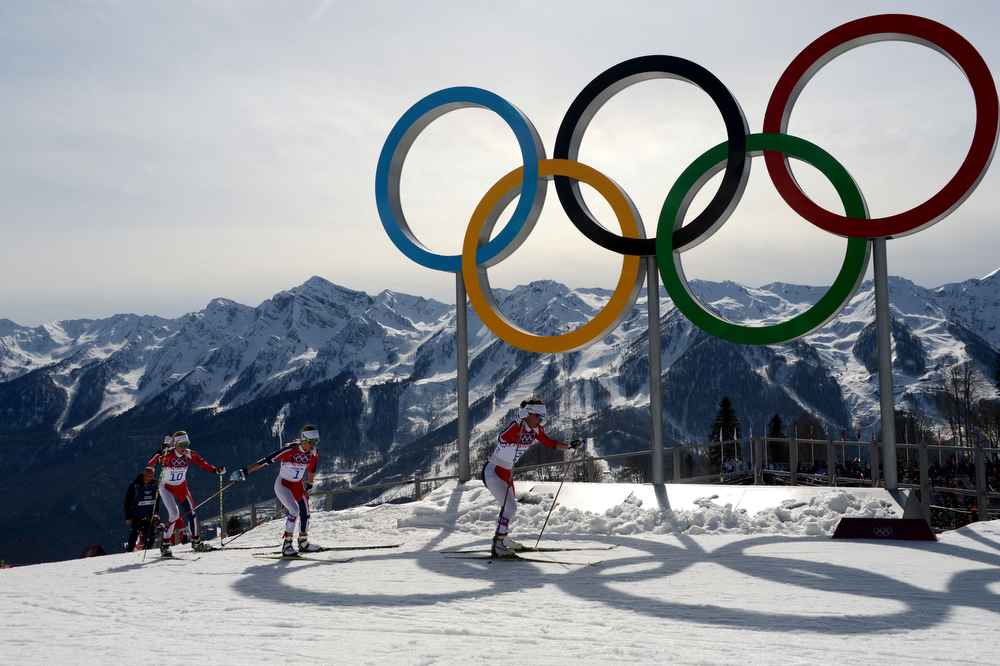 . (LtoR) Norway\'s Kristin Stoermer Steira, Norway\'s Therese Johaug and Norway\'s Marit Bjoergen  compete by the Olympic Rings in the Women\'s Cross-Country Skiing 30km Mass Start Free at the Laura Cross-Country Ski and Biathlon Center during the Sochi Winter Olympics on February 22, 2014, in Rosa Khutor, near Sochi. (KIRILL KUDRYAVTSEV/AFP/Getty Images)