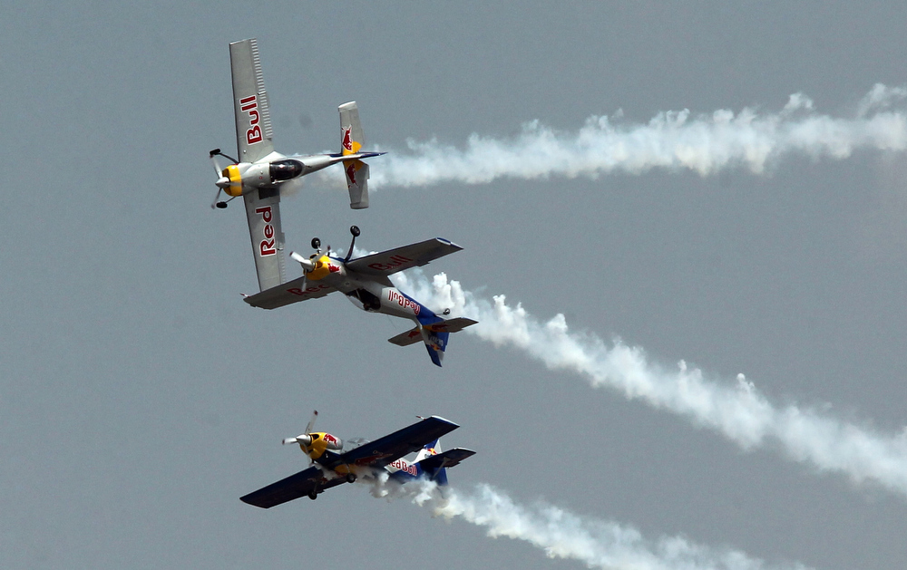 Description of . Members of The Flying Bulls aerobatics team from the Czech Republic fly in formation in their Zlin Z-50's during the second day of the ongoing 9th Edition of Aero India Show 2013 in Bangalore on February 7, 2013. India, the world's leading importer of weaponry, is hosting one of Asia's biggest aviation trade shows with Western suppliers eyeing lucrative deals and a Chinese delegation attending for the first time. AFP PHOTO/ STRSTR/AFP/Getty Images