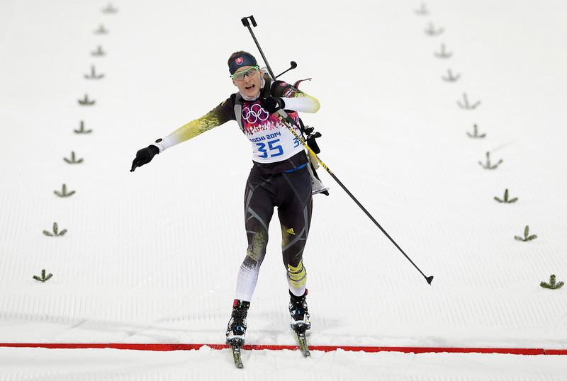 . Slovakia\'s Anastasiya Kuzmina crosses the line during the women\'s 15K individual biathlon race at the 2014 Winter Olympics, Friday, Feb. 14, 2014, in Krasnaya Polyana, Russia. (AP Photo/Matthias Schrader)