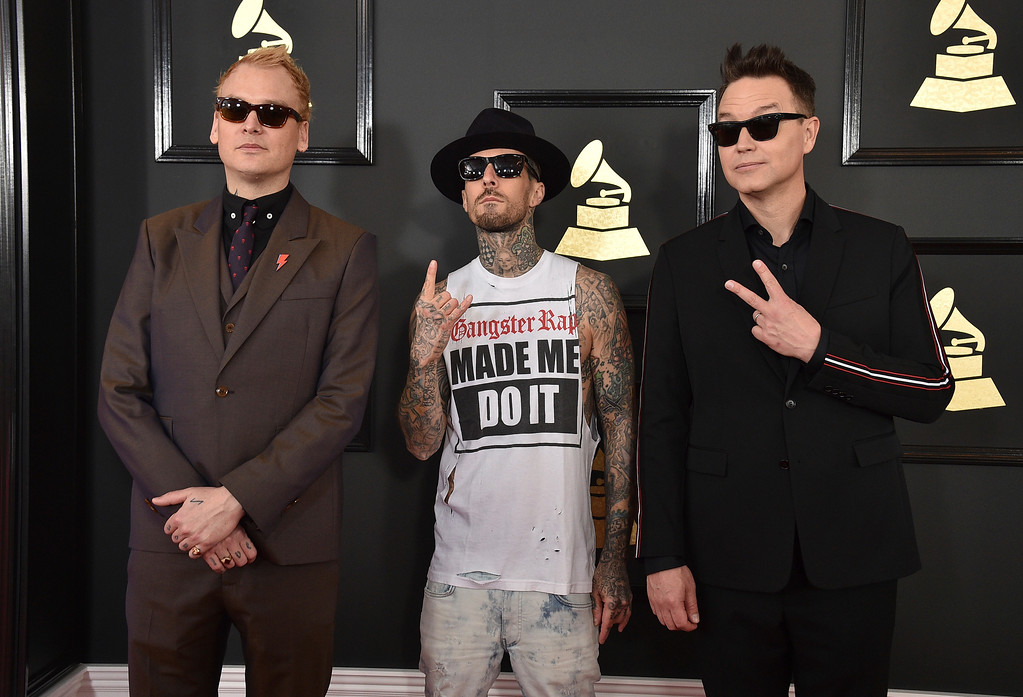 . Matt Skiba, from left, Travis Barker, and Mark Hoppus of the musical group Blink-182 arrive at the 59th annual Grammy Awards at the Staples Center on Sunday, Feb. 12, 2017, in Los Angeles. (Photo by Jordan Strauss/Invision/AP)