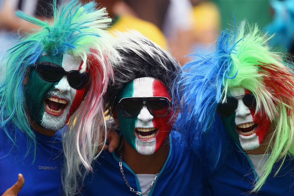 . taly fans soak up the pre-match atmopshere during the 2014 FIFA World Cup Brazil Group D match between Italy and Uruguay at Estadio das Dunas on June 24, 2014 in Natal, Brazil.  (Photo by Clive Rose/Getty Images)