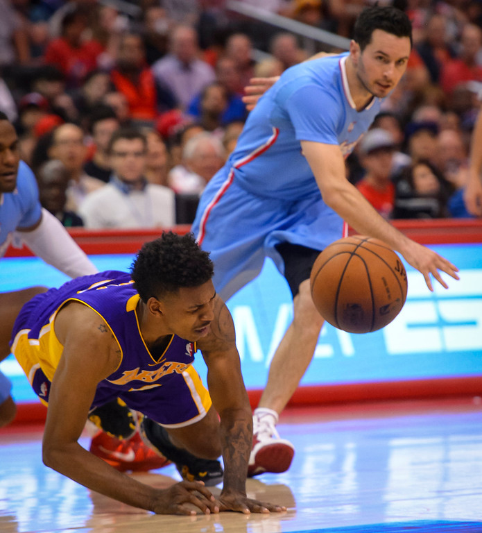 . Lakers� Nick Young goes down trying to chase down a loose ball during game action at Staples Center Sunday April 6, 2014. Clippers defeated the Lakers 120-97.  ( Photo by David Crane/Los Angeles Daily News )