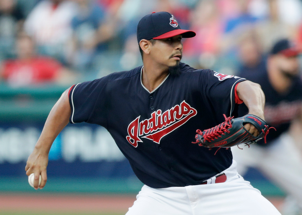 . Cleveland Indians starting pitcher Carlos Carrasco delivers in the first inning of a baseball game against the Minnesota Twins, Tuesday, Aug. 28, 2018, in Cleveland. (AP Photo/Tony Dejak)