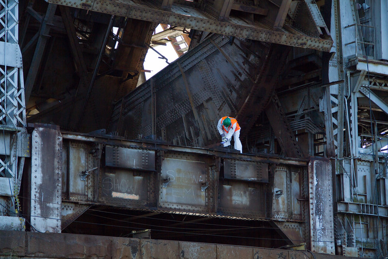 A worker on the rail bridge.
