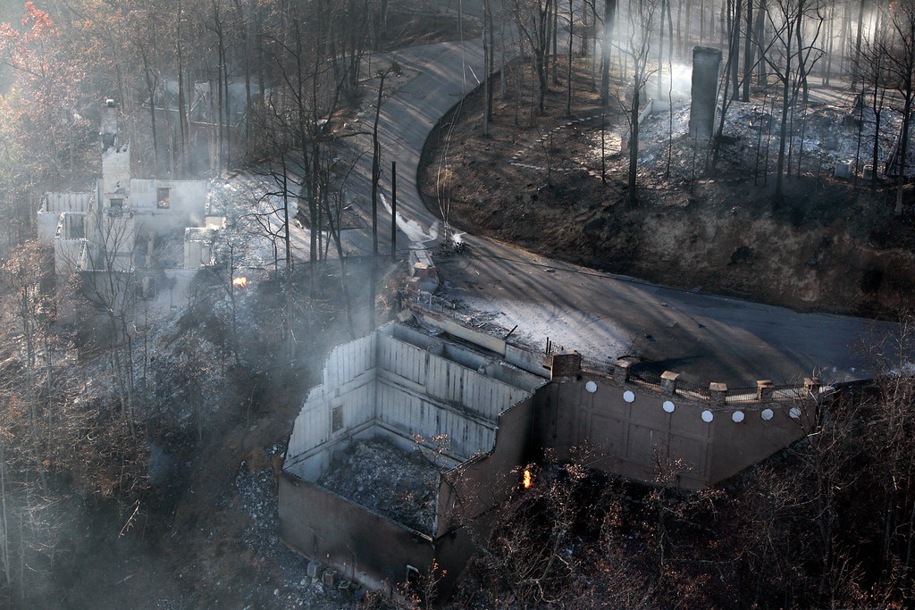 . An aerial photo shows homes Tuesday, Nov. 29, 2016, that were destroyed by a wildfire near Gatlinburg, Tenn. Thousands of people have fled wildfires that killed at least three people and destroyed hundreds of homes and a resort in the Great Smoky Mountains. (AP Photo/Wade Payne)
