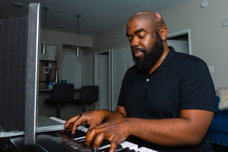 Carlton Williams sits at his keyboard and plays Christmas songs in his apartment in Boynton Beach on Saturday, November 23, 2019. Williams was seriously injured in a hit-and-run crash near the intersection of Ocean Avenue and North Federal Highway in September 2019, less than a block from his apartment.  [JOSEPH FORZANO/palmbeachpost.com]