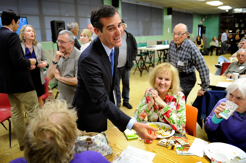 . Mayoral candidate Eric Garcetti greets people before his debate with Wendy Greuel at Notre Dame High School, Wednesday, April 17, 2013. (Michael Owen Baker/Staff Photographer)