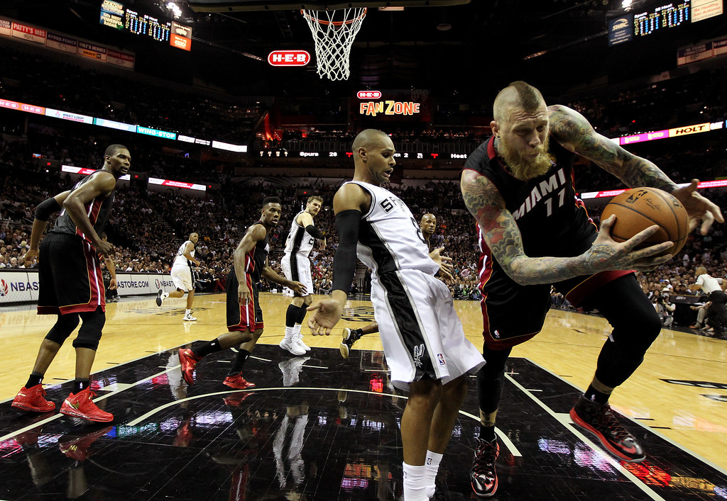 . Patty Mills #8 of the San Antonio Spurs and Chris Andersen #11 of the Miami Heat battle for a loose ball during Game Two of the 2014 NBA Finals at the AT&T Center on June 8, 2014 in San Antonio, Texas.  (Photo by Andy Lyons/Getty Images)