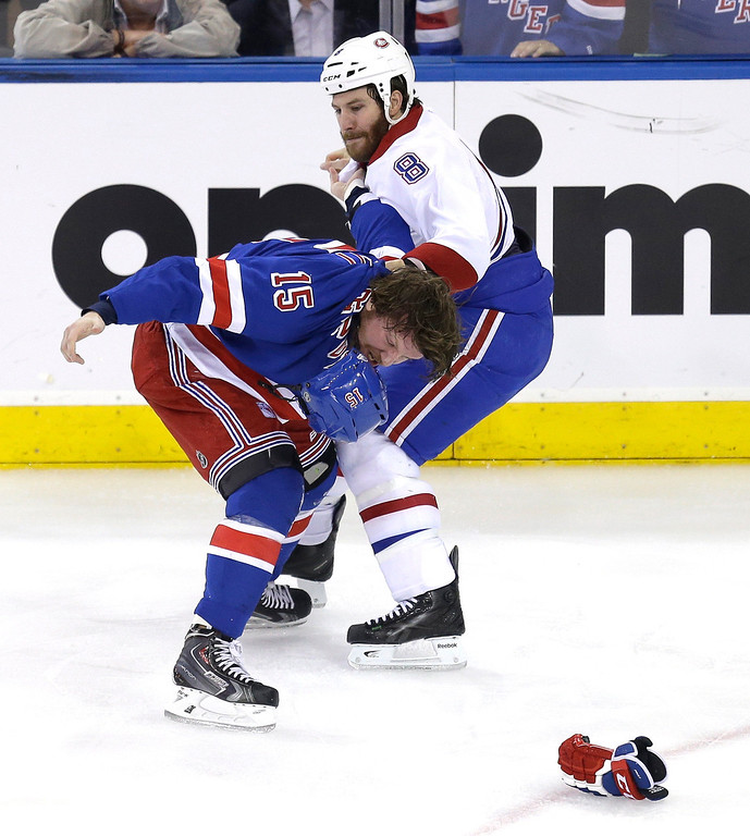 . Montreal Canadiens\' Brandon Prust, right, and New York Rangers\' Derek Dorsett fight during the first period of Game 3 of the NHL hockey Stanley Cup playoffs Eastern Conference finals, Thursday, May 22, 2014, in New York. (AP Photo/Seth Wenig)
