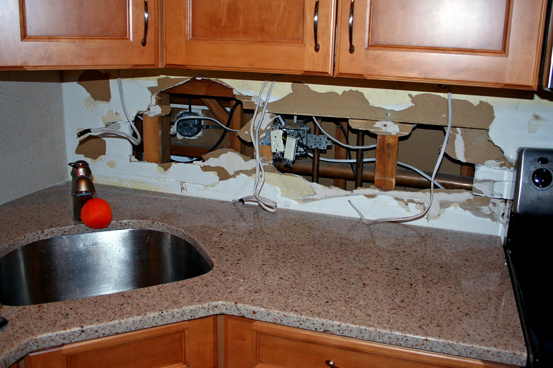 Backsplash is out and so is parts of the wall it was glued to! Note only one of the backsplashes were able to be removed.