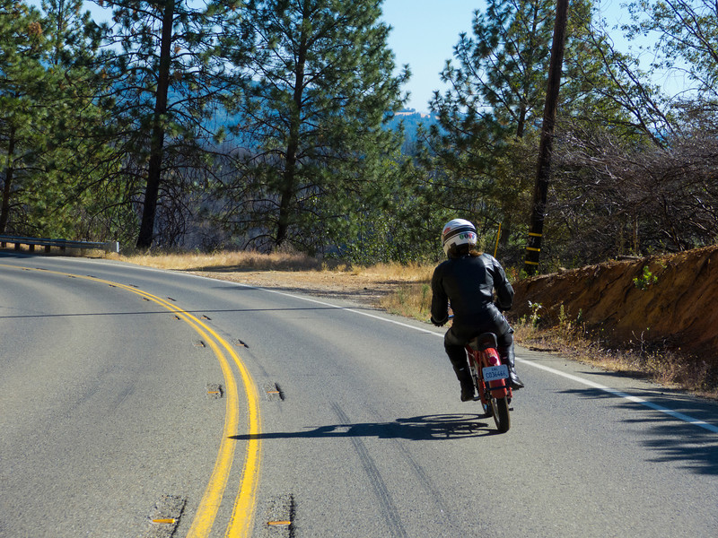 Patrick Owens on  CA 49 right before the New Bullards Bar Dam, doing about 50 mph on his 50cc bike.
