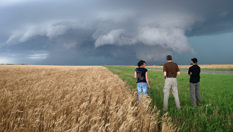 A team of stormchasers watching a supercell storm. There was some great structure in this storm and I hung around a good few minutes behind my team waiting for a look or turn, something to bring across the human factor in the frame. The young lady duly obliged and I had my shot. 