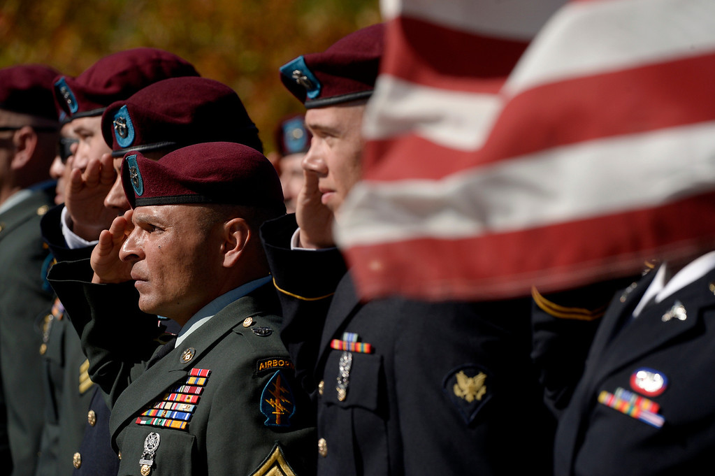 . DENVER, CO. - OCTOBER 02:Members of the Colorado National Guard salute during a burial ceremony for Special Forces Soldier Liam Nevins  at Fort Logan National Cemetery in Denver,CO October 02, 2013. (Photo By Craig F. Walker / The Denver Post)