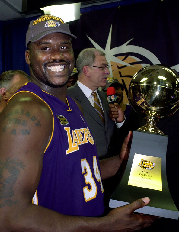 . Los Angeles Lakers\' Shaquille O\'Neal poses with his most valuable player trophy after defeating Philadelphia 76ers 108-96 in game 5 to win their second straight NBA championship, Friday, June 15, 2001 in Philadelphia. (AP Photo/Mark Terrill)