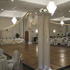 Calla Lilly Wedding-Decorated Head Table, Backdrop and Dance Canopy.  The tablecovers and chairs are cream with silver silk sashes.  Maneeley's in South Windsor, CT