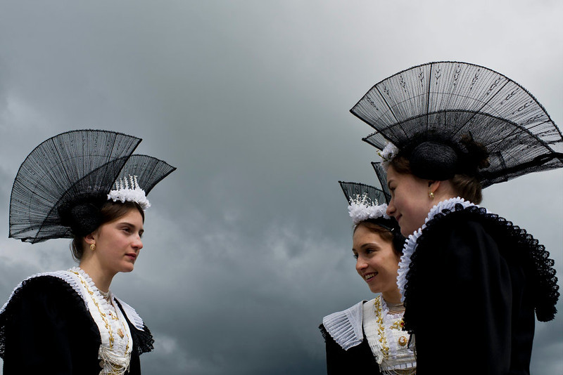 . Women in their traditional costumes chat under a dark sky after a Corpus Christi mass in Appenzell, Switzerland, Thursday, May 30, 2013. (AP Photo/Keystone,Ennio Leanza)