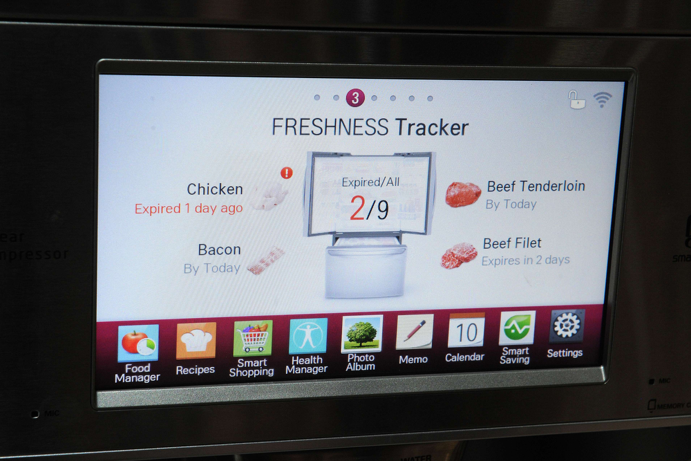 Description of . The display embedded in the front of a LG smart refrigerator on the final day of the 2014 International CES, January 10, 2014 in Las Vegas, Nevada. The LG Smart Home system with the Home Chat smart platform allows users to communicate with home appliances via text message. (Robyn Beck/AFP/Getty Images)