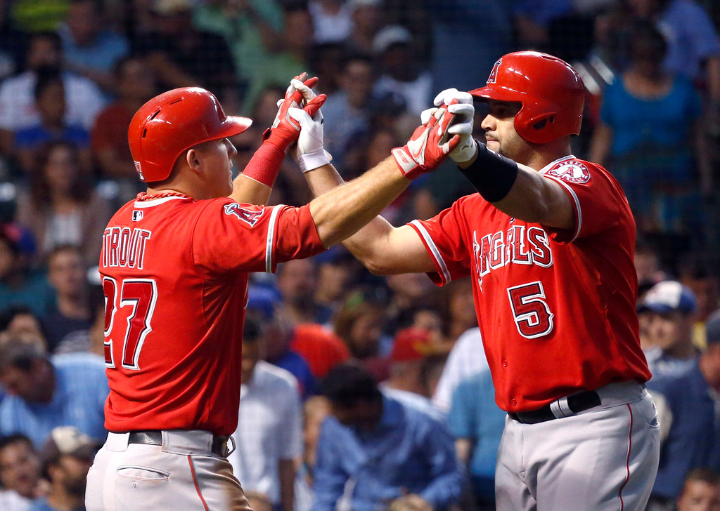 . Los Angeles Angels\' Albert Pujols, right, celebrates his two-run home run with Mike Trout, off Chicago Cubs starting pitcher Jeff Samardzija, also scoring Trout, during the fifth inning of an interleague baseball game Wednesday, July 10, 2013, in Chicago. (AP Photo/Charles Rex Arbogast)