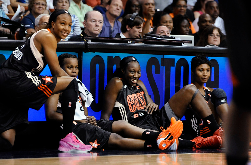 . East\'s Cappie Pondexter, of the New York Liberty; Epiphanny Prince, of the Chicago Sky; Tina Charles, of the Connecticut Sun; and  Angel McCoughtry, of the Atlanta Dream, wait to be called into play during the first half. (AP Photo/Jessica Hill)