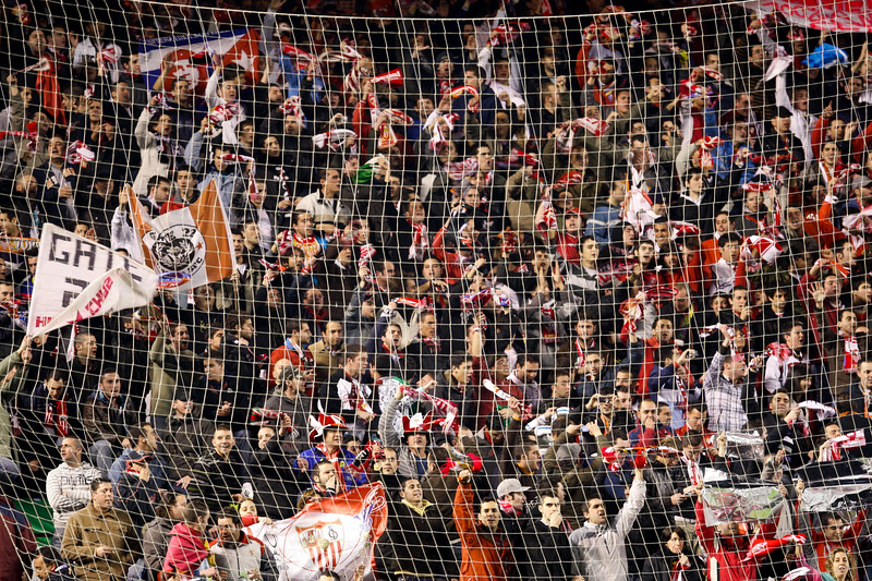 Sevilla FC fans doing a tifo. Taken during the football derby between Sevilla FC and Real Betis Balompie that took place in Sanchez Pizjuan stadium on 7 Feb 2009, Seville, Spain.