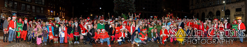 The group photo of Santacon Portland 2014 in Monument Square by the Christmas Tree