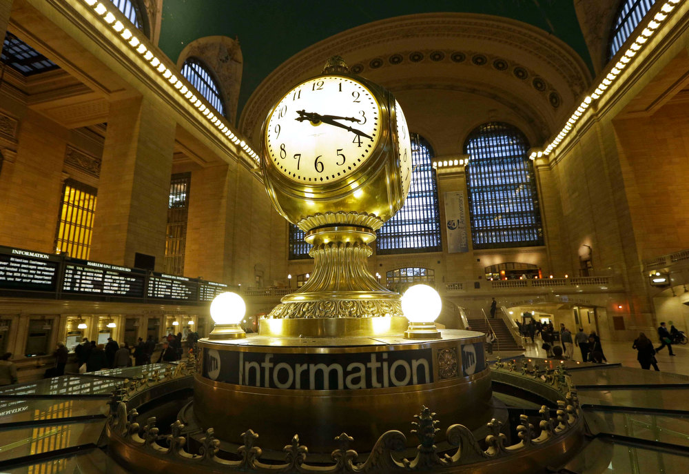 . In this Jan. 9, 2013 file photo, the famous opalescent clock keeps time at the center of the main concourse in Grand Central Terminal is shown in New York.  The country\'s most famous train station and one of its finest examples of Beaux Arts architecture in America turns 100 on Feb. 1.  The building\'s centennial comes 15 years after a triumphant renovation that  removed decades of grime and decay. (AP Photo/Kathy Willens, File)