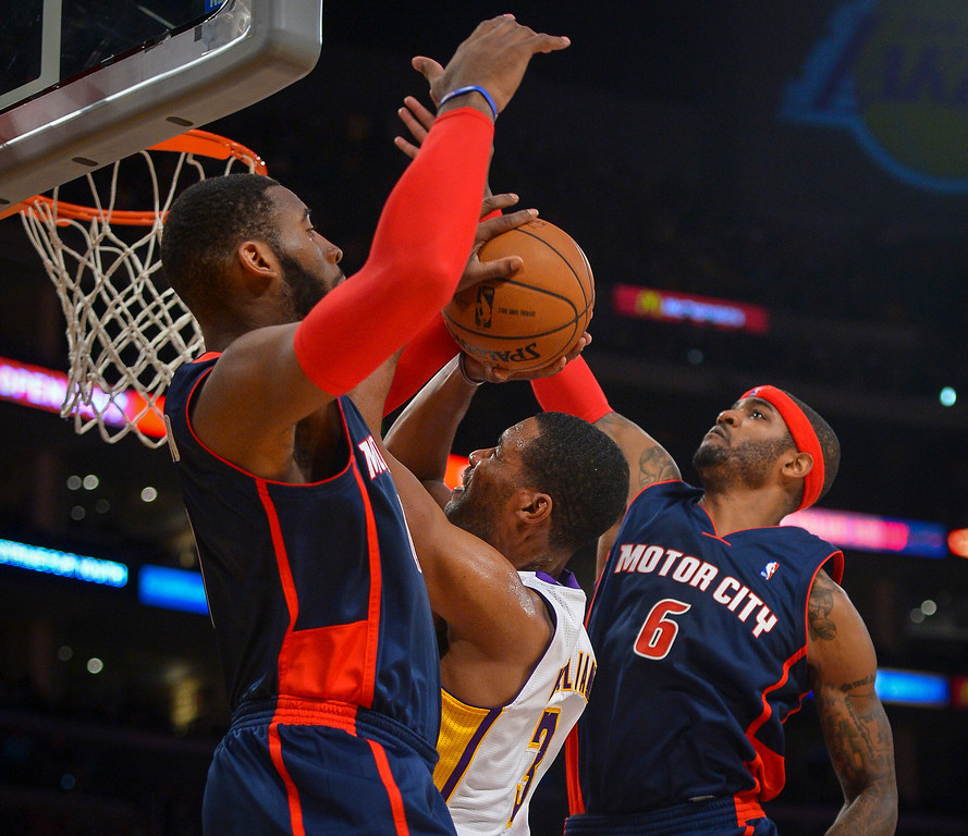 . Lakers� Shawne Williams tries to pull in a rebound against Detroit�s Josh Smith and Andre Drummond during first half action at Staples Center Sunday, November 17, 2013.  ( Photo by David Crane/Los Angeles Daily News )