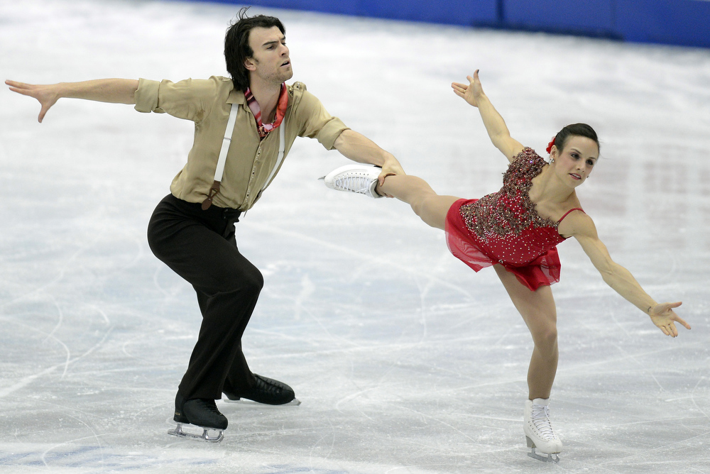 Description of . Meagan Duhamel and Eric Radford of Canada skate in the Pairs Short Program during day one of the ISU Four Continents Figure Skating Championships at Osaka Municipal Central Gymnasium on February 8, 2013 in Osaka, Japan.  (Photo by Atsushi Tomura/Getty Images)
