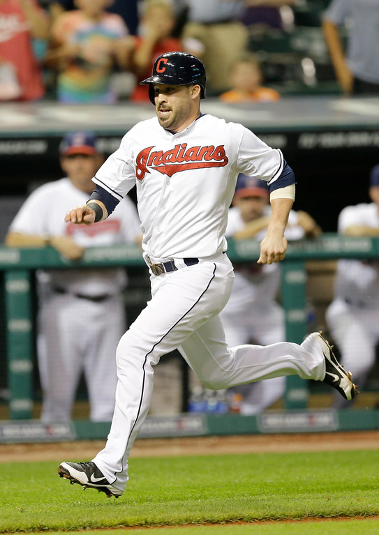 . Cleveland Indians\' Jason Kipnis scores on a single by Lonnie Chisenhall in the sixth inning of a baseball game against the Detroit Tigers, Thursday, Sept. 4, 2014, in Cleveland. (AP Photo/Tony Dejak)