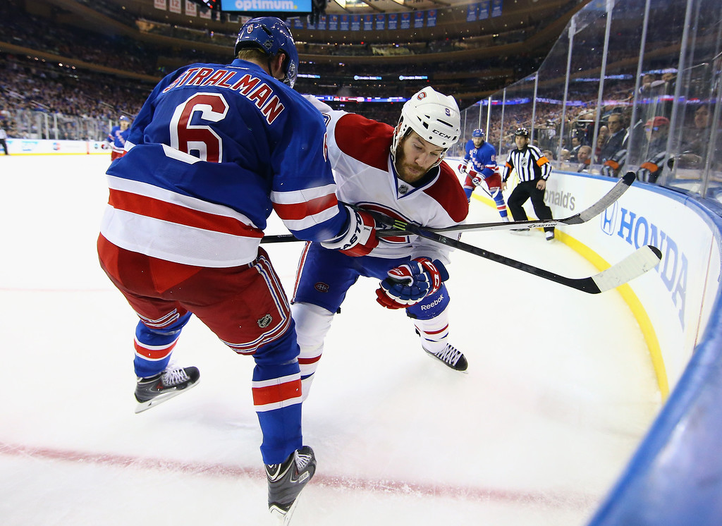 . Brandon Prust #8 of the Montreal Canadiens gets tangled up against Anton Stralman #6 of the New York Rangers in Game Three of the Eastern Conference Final during the 2014 NHL Stanley Cup Playoffs at Madison Square Garden on May 22, 2014 in New York City.  (Photo by Al Bello/Getty Images)