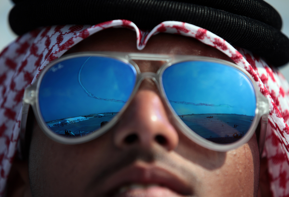 . A Bahraini man watches the Bahrain International Airshow on Thursday, Jan. 16, 2014, in Sakhir, Bahrain. Bahrain\'s state news agency said the International Airshow opened to announcements of more than $3 billion in agreements. (AP Photo/Hasan Jamali)