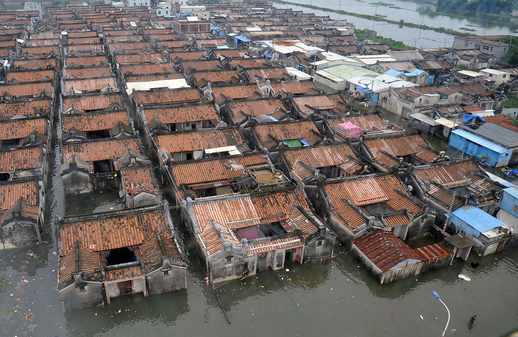 . A residential area submerged by floodwaters in Shantou, in southern China\'s Guangdong province on August 21, 2013. The death toll from devastating floods at opposite ends of China following torrential rains and the aftermath of a typhoon has risen to more than 130, the government and media said on August 20.   AFP PHOTOSTR/AFP/Getty Images