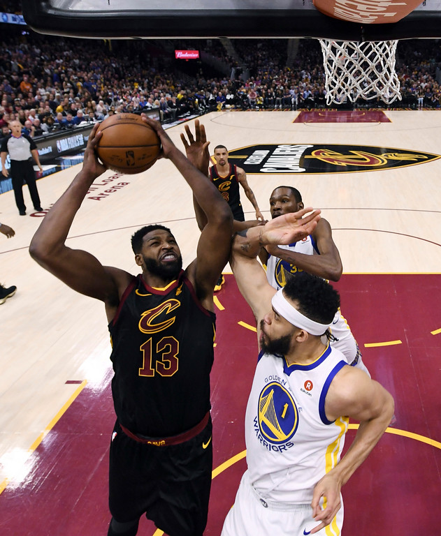 . Cleveland Cavaliers\' Tristan Thompson shoots against Golden State Warriors\' JaVale McGee during the first half of Game 4 of basketball\'s NBA Finals, Friday, June 8, 2018, in Cleveland. (Gregory Shamus/Pool Photo via AP)