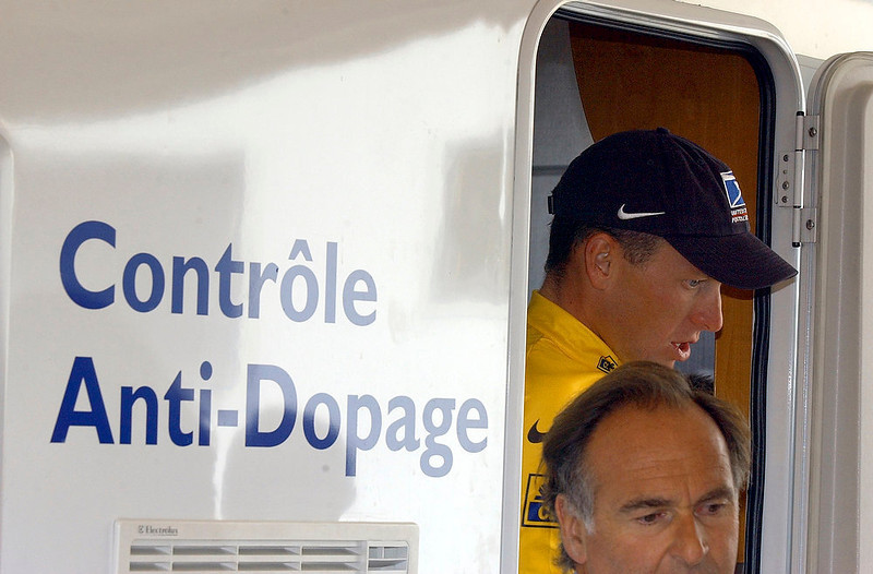 ". Cyclist Lance Armstrong of Austin, Texas, walks out of  the Tour de France\'s anti-doping control bus after the 16th stage of the Tour de France cycling race between Les Deux Alpes and La Plagne, French Alps on July 24, 2002. The U.S. Anti-Doping Agency is bringing doping charges against the seven-time Tour de France winner, questioning how he achieved those famous cycling victories.  Armstrong, who retired from cycling last year, could face a lifetime ban from the sport if he is found to have used performance-enhancing drugs. He maintained his innocence, saying: ""I have never doped.\"" (AP Photo/Peter Dejong, File)"
