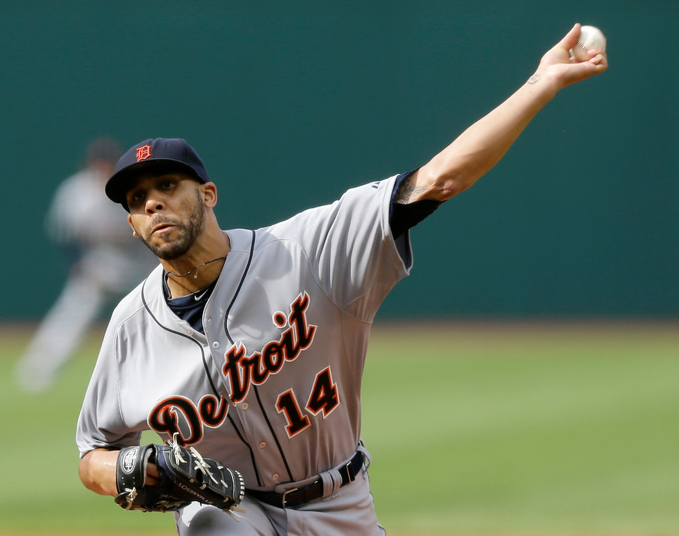 . Detroit Tigers starting pitcher David Price delivers in the first inning of a baseball game against the Cleveland Indians, Monday, Sept. 1, 2014, in Cleveland. (AP Photo/Tony Dejak)