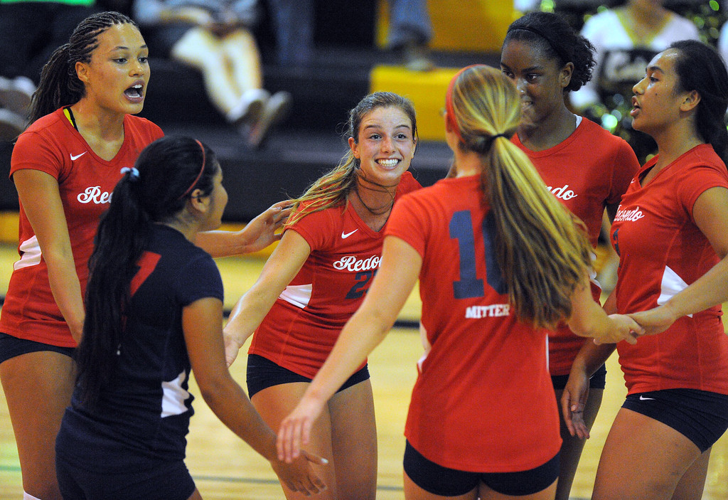 . Redondo girls volleyball takes on Bishop Montgomery in a non league match in Torrance on 09/10/2013. Redondo won 3-0. Redondo players celebrate a point in game 2. (Photo by Scott Varley, Daily Breeze)