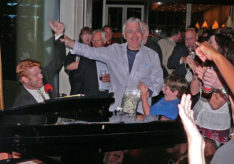 Jason Ostrowski WOWING them on the piano and our director Bill Kenwright congratulating him!