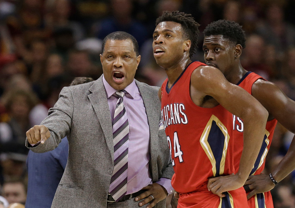 . New Orleans Pelicans head coach Alvin Gentry talks with Buddy Hield (24), from Bahamas, in the second half of an NBA basketball game against the Cleveland Cavaliers, Monday, Jan. 2, 2017, in Cleveland. The Cavaliers won 90-82. (AP Photo/Tony Dejak)