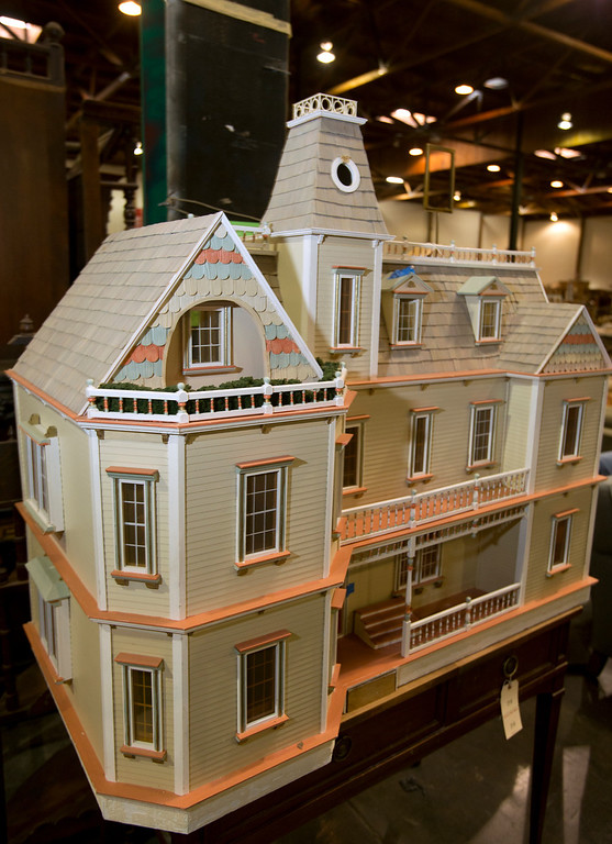 . A handmade dollhouse is among the merchandise available at the annual White Elephant Sale, at the Oakland Museum Women\'s Board 96,000-square-foot warehouse in Oakland, Calif., Tuesday, Jan. 15, 2013. (D. Ross Cameron/Staff)